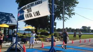 Anna's husband Josh breaks the finish line tape!